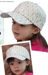 หมวแก๊ปสีขาวสกรีนอักษร LST สีทองจาก Lemonkid