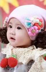 หมวกปอยผมเด็กหญิงสีชมพูอ่อนแต่งกระต่ายและดอกไม้นูน
