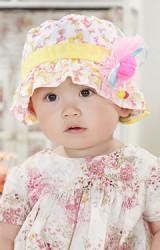 หมวกสาวน้อยลายโบว์ ด้านหน้าแต่งดอกไม้ ผูกโบว์หลัง