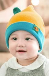 หมวกบีนนี่ยอดแหลมพับขอบแต่งป้ายผลส้มและใบ  จาก GZMM