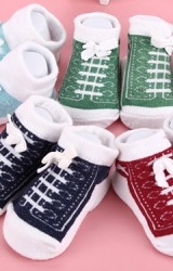ถุงเท้าเด็กเล็กลายรองเท้าแต่งโบว์ผูกเล็กๆ