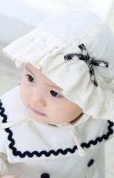 หมวกสาวน้อยผ้าฝ้ายสีครีมแต่งโบว์ลายสก๊อต