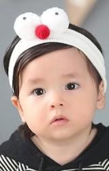 ผ้าคาดผมสีขาวครีมแต่งตุ๊กตาตาโต จาก Angel Neitiri